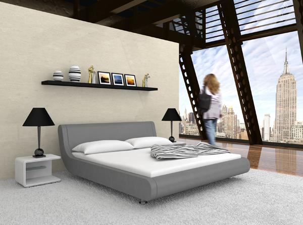 Sypialnia w stylu nowoczesnym to najczęściej duże, tapicerowane łóżko w kolorze białym, czarnym lub szarym oraz neutralne kolory