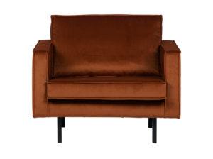 Minimalistyczny fotel w kolorze rdzy. Wykonany z miękkiej tkaniny velvet. Idealny do salonu lub gabinetu